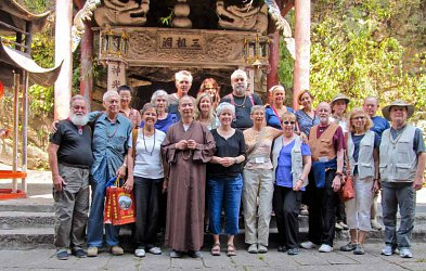 This is a group Annie was with visiting the Third Ancestor's Temple (Sengcan's Temple). The Abbot, Kuanrong is in front, Bill Porter (a.k.a. Red Pine) is to the far left in the first row, standing next to Senseis Gregory and Janet Abels. Annie is in the second row, just behind the Abbot.